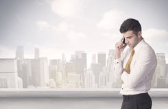 Sales person talking in front of city scape Stock Images