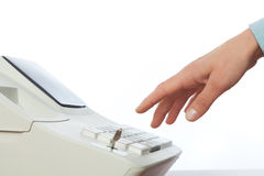 Sales persons hand  going to enter amount on cash register in re Royalty Free Stock Photo