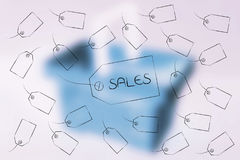 Sales price tag surrounded by other labels flying around Stock Photo