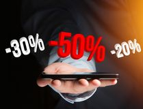 Sales promotion 20% 30% and 50% flying over an interface - Shopping concept. View of a Sales promotion 20% 30% and 50% flying over an interface - Shopping stock photos