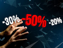 Sales promotion 20% 30% and 50% flying over an interface - Shopping concept. View of a Sales promotion 20% 30% and 50% flying over an interface - Shopping royalty free stock photo