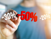 Sales promotion 20% 30% and 50% flying over an interface - Shopping concept. View of a Sales promotion 20% 30% and 50% flying over an interface - Shopping royalty free stock photography