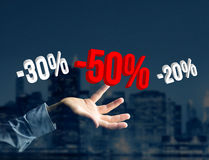 Sales promotion 20% 30% and 50% flying over an interface - Shopping concept. View of a Sales promotion 20% 30% and 50% flying over an interface - Shopping stock photo