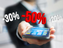 Sales promotion 20% 30% and 50% flying over an interface - Shopp Stock Image