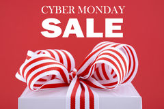Sales Promotion Gift Box. Cyber Monday red and white sales promotion gift box closeup against a red background with sample text Royalty Free Stock Image