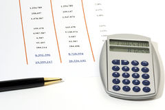 Sales Report. Statement of Financial Position with ball pen and calculator Stock Image