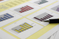 Sales report. Colorful sales charts with pen Stock Photo