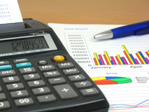 Sales Report 3. Colorful sales charts, calculator and blue pen Stock Photo