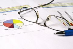 Sales report. Colorful sales charts with ball pen Royalty Free Stock Photography