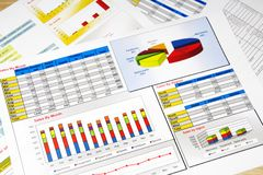 Sales Report in Statistics, Graphs and Charts. Colored Royalty Free Stock Photography