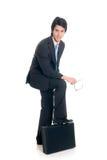 Sales representative. Handsome successful young sales representative, joyful expression, studio shot Stock Photos