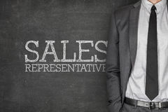 Sales representative on blackboard. With businessman on side Royalty Free Stock Photo