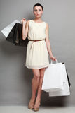 Sales, retail and woman shopping time. Stock Images