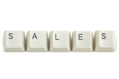 Sales from scattered keyboard keys on white Stock Images