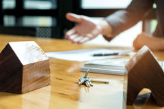 Sales are selling home. There are documents with the replica and. The keys on the table.Real estate concept Stock Image