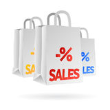Sales shopping bags isolated. Illustrated shopping bags with sales text upon related to store sales and special offers, vector file available Stock Photos