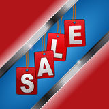 Sales sigh with red tags and white letters over blue and red bac Royalty Free Stock Photo