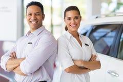 Sales staff vehicle showroom Stock Image