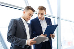 Sales statistics. Young businessmen discussing sales level stock photo