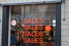 Sales in store. Summer sales in clothes store Stock Photos