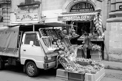 Sales in the street in Valletta, unidentified people Royalty Free Stock Images