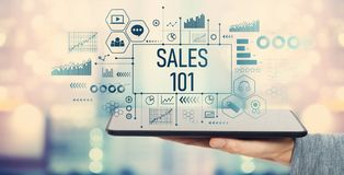 Sales 101 with tablet computer. Sales 101 with man holding a tablet computer royalty free stock images