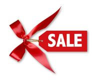 Sales Tag With Big Red Ribbon Bow Tied. On White WIth Shadow Stock Photography