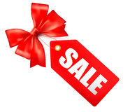 Sales tag with red gift bow Stock Photo