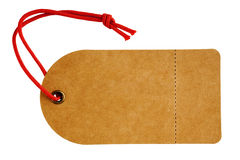 Sales Tag or Swing Ticket in Brown Cardboard. Sales tag or swing ticket, made from a rough textured brown card, with red string, perforated tear off sales label Stock Photo