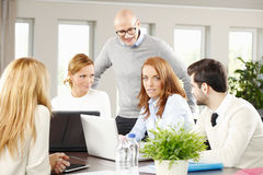 Sales team with computer Royalty Free Stock Photography