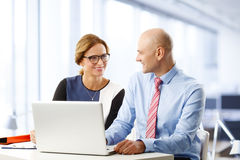 Sales team with laptop Royalty Free Stock Image