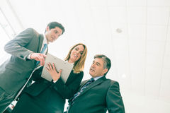 Sales team look at a clipboard Stock Photos