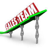 Sales Team Working Together Reaching Selling Goal Stock Photo