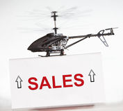 Sales up with helicopter. Metaphor in business Stock Photo