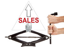 Sales up with screw jack. Isolated. White background Royalty Free Stock Photos