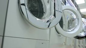 Sales of washing machines in the store stock video footage