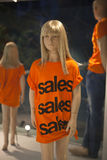 Sales window. Mannequin wearing a sales t shirt at a sales window Stock Photo