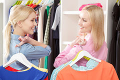 Sales woman and a customer with hangers Stock Photo