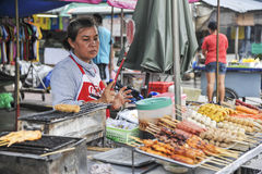 Sales woman at the market in Bangkok, Thailand Stock Image