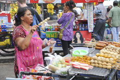 Sales woman at a market in Bangkok, Thailand Stock Photography