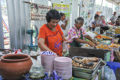 Sales woman at a market in Bangkok, Thailand Royalty Free Stock Images