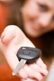 Sales woman offering car keys. Young sales woman offering car keys Stock Photography