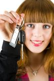 Sales woman offering car keys. Young attractive sales woman offering car keys Royalty Free Stock Image