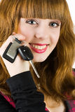 Sales woman offering car keys. Young attractive sales woman offering car keys Royalty Free Stock Images
