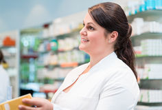 Sales woman in pharmacy or drug store Royalty Free Stock Photos