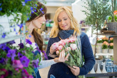Sales Woman Showing Flower Bouquet To Customer At Stock Photography