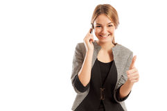 Sales woman talking on the phone and showing thumbs-up Royalty Free Stock Photos