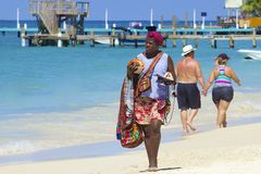 Sales woman in West Bay beach in Honduras, Caribbean Stock Images