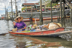 Happy woman in a boat on the floating market Royalty Free Stock Photos