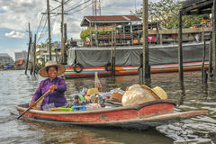 Sales women in a boat on the floating market Stock Image